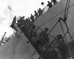 American troops leaving the first troop transport to enter Cherbourg harbor, 25 Jul 1944