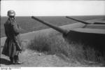 German soldier on sentry on the Danish coast, 1940; note armored coastal batteries