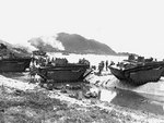 Amphibious tractors delivering US Marines and supplies on the beach of Ibeya, an island in the Ryukyu Islands northwest of Okinawa, 3 Jun 1945