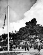 Raising the US flag on Okinawa, Japan, 22 Jun 1945
