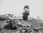 US Army observers calling in artillery fire against a Japanese position on Okinawa, Japan, circa Apr-Jun 1945