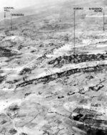 Aerial view of Tombstone Ridge area, Okinawa, Japan, 10 Jul 1945