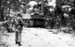 Men and M4 Sherman tank of the 382nd Infantry Regiment, US 96th Division on the Ginowan Road, Okinawa, Japan, circa Apr-Jun 1945