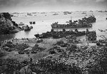 American ships landing troops and supplies on a beach on Okinawa, Japan, 13 Apr 1945