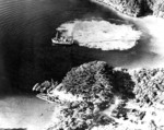 Aerial photograph taken during bombing of a Japanese forward submarine base on Okinawa, Japan, Mar 1945