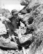 Man of US 1st Marine Division comforting a fellow Marine who had just witnessed the death of a friend, Okinawa, Japan, May 1945