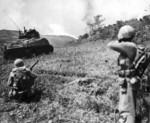 US Marine flamethrower and rifle squad attacking a Japanese position on Okinawa, Japan, 11 May 1945