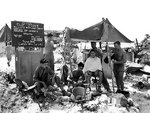 A barber shop set up by an American Marine on Peleliu, Palau Islands, 11 Oct 1944