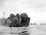 Amphibious tractor coming out of LST-225, delivering the first wave of landers on Peleliu, Palau Islands, 15 Sep 1944