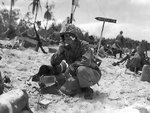 Lieutenant Colonel R. G. Balance of US 1st Marine Division at the shore party command post, Peleliu, Palau Islands, Sep 1944; note treated shrapnel wound on his left cheek