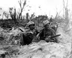 Two American Marines, Douglas Lightheart and Gerald Thursby, resting during Battle of Peleliu in the Palau Islands, 15 Sep 1944