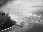 The first wave of LVTs moved toward Peleliu invasion beaches, Palau Islands, 15 Sep 1944; note the bombardment lines consisted of LCIs, cruisers, and battleships; photo taken USS Honolulu aircraft