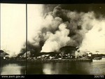 Smoke rising from the port facilities at Oosthaven, Sumatra as Allied personnel set fires during the withdrawal, 20 Feb 1942