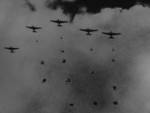 Japanese paratroopers descending on Pangkalan Benteng airfield or Pladju refineries in southern Sumatra, Dutch East Indies, 13 Feb 1942, photo 2 of 2