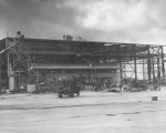 Wrecked hangar building and two damaged OS2U aircraft, Naval Air Station Ford Island, Oahu, US Territory, 8 Dec 1941