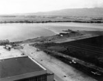 View of Naval Air Station Ford Island, Oahu, US Territory of Hawaii, 8 Dec 1941; note OS2U, SOC, PBY-5, F4F-3, and TBD-1 aircraft