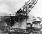 Blistered paint and other fire damage to the forward hull of battleship Pennsylvania, in Drydock Number One at the Pearl Harbor Navy Yard, 7 Dec 1941