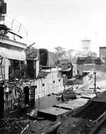 Starboard view of destroyer Downes, burned out and sunk in Pearl Harbor Navy Yard