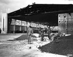 Bomb damage to Hangars 15-17 and 11-13 at Hickam Field, Oahu, at 1700 on 7 Dec 1941; note B-18 bomber in hanger
