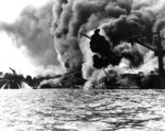 USS Arizona burning at Pearl Harbor, 7 Dec 1941, photo 1 of 5