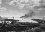 USS Arizona and other Pearl Harbor ships burning in the distance, photo taken from Aeia Heights, Oahu, US Territory of Hawaii, 7 Dec 1941