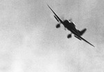Japanese D3A dive bomber in flight over Pearl Harbor, Oahu, US Territory of Hawaii, 7 Dec 1941. Note dive brakes.