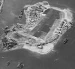 Aerial view looking south at Ford Island, Pearl Harbor, US Territory of Hawaii, 30 Oct 1941; note partial view of Battleship Row at left and USS Enterprise at upper left