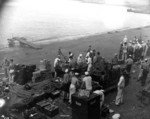 Sailors at Naval Air Station Ford Island reloading ammunition clips and belts between Japanese attack waves, Oahu, US Territory of Hawaii, 7 Dec 1941