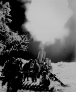 Men of the US 90th Field Artillery fired their gun at a Japanese position, Balete Pass, Luzon, 19 Apr 1945
