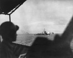 A Mahan-class destroyer, possibly Drayton or Lamson, bombarding the objective area during landings on the shores of Ormoc Bay, Leyte, Philippine Islands, 7 Dec 1944
