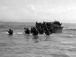 First wave of American troops storming ashore from amphibious landing craft, Leyte, Philippine Islands, 20 Oct 1944, photo 2 of 3