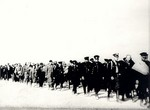 Polish policemen and civilians, captured by Russian troops, marching in a column, Sep 1939
