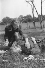 Ten-year-old Polish girl Kazimiera Mika mourning the death of her sister, caused by strafing German aircraft, near Warsaw, Poland, 13 Sep 1939
