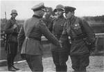 German and Soviet officers shaking hands, Poland, late Sep 1939