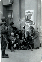 Polish family huddling before the Grand Theatre, Warsaw, Poland, Sep 1939