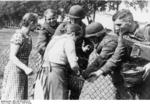 German women living in Poland giving bread to German soldiers, Poland, 2 Sep 1939