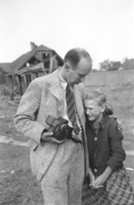 Photographer Julien Bryan comforting ten-year-old Polish girl Kazimiera Mika whose sister had just been killed by strafing German aircraft, near Warsaw, Poland, 13 Sep 1939