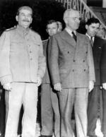 Joseph Stalin and Harry Truman during the Potsdam Conference, Germany, 20 Jul 1945; note V. N. Pavlov and Andrei Gromyko in background