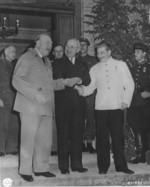 Churchill, Truman, and Stalin shaking hands during the Potsdam Conference, Germany, 23 Jul 1945, photo 2 of 3