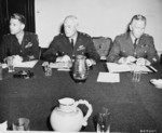 Major General Lauris Norstad, General Henry Arnold, and General George Marshall at a meeting during the Potsdam Conference, Germany, 21 Jul 1945