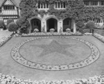 Courtyard of Cecilienhof Palace, Potsdam, Germany, 13 Jul 1945; note star formed by red begonias
