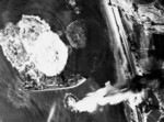 Japanese tanker under air attack, Kure, Japan, 24 Jul 1945