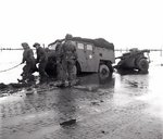 A Canadian gun-tractor skidded off the road on the flooded island of Beveland, the Netherlands, 28 Oct 1944