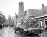 Canadian Royal Hamilton Light Infantry carriers moving through the Dutch village of Krabbendijke on the Beveland Causeway, 27 Oct 1944