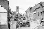 Canadian Daimler and Humber armored cars in the Belgian-Dutch border town of Putte, 11 Oct 1944; note Sint-Dionysiuskerk in background, and the photo was likely taken on the border looking north into the Netherlands