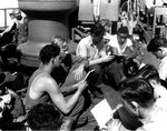 Soldiers and sailors singing hymns during religious services on board LST-4 en route to Southern France, 13 Aug 1944