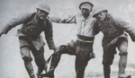 Two Japanese soldiers helping a wounded comrade off the battlefield near Suzhou Creek, Shanghai, China, late Oct 1937