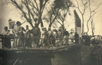 Japanese soldiers walking among Chinese refugees near the village of Shengjiaqiao in Baoshan, Jiangsu, China, 14 Oct 1937; seen in 10 Nov 1937 issue of Japanese publication Asahigraph