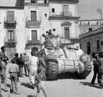 British Sherman tank of XIII Corps, Eighth Army in the streets of Francofonte, Sicily, 13-14 Jul 1943