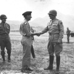 General Bernard Montgomery saying farewell to Lieutenant General George Patton at an airfield near Palermo, Sicily, Italy after Montgomery